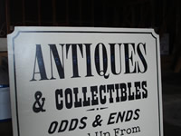 detail of antiques sign