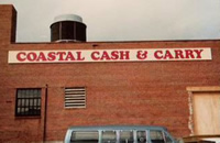 coastal cash and carry sign