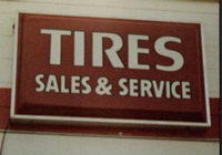 tire sales and service sign