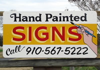 hand painted signs sign